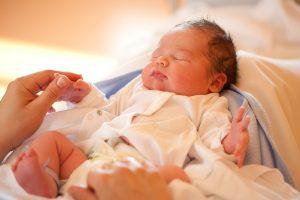 newborn baby on mother's lap