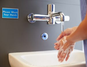 Close Up Of Medical Staff Washing Hands