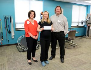 Robin McLey scholarship winner with Teresa Butler and Josh Lander in physical therapy department