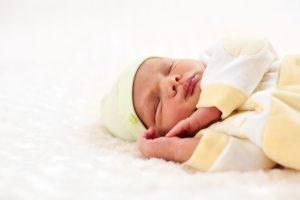 Closeup portrait of a one week old baby boy asleep